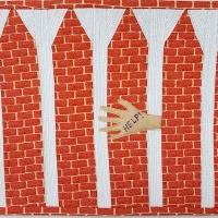 This brick's design is quite literal, using brick motif fabric with a hand reaching through a gap, pleading for help.