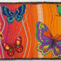 I live 30 miles from the border wall at Mariposa station which divides Nogales AZ and Mexico. A quilt wall sounds so much better.