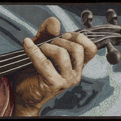 Hand holding the neck of a fiddle is visible with a mottled blue-green background.