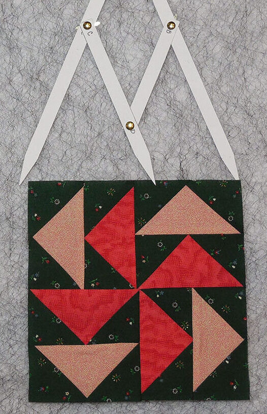 Adjust the Golden Mean Calipers to measure the width of a quilt block
