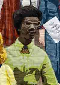 Shirley Chisolm fabric portrait from Women's Work quilt, front view, wearing lime green dress.