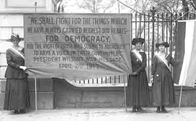Suffragette Movement Women hold large banner on display when dignitaries visit.