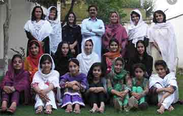 photo of the girls attending the Yousafzai school for girls. Her father, center back placed a high vale on educating girls.